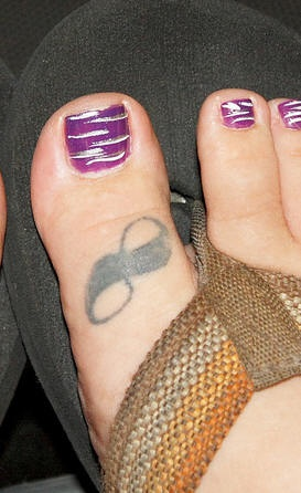 Infinity symbol tattoo on big toe