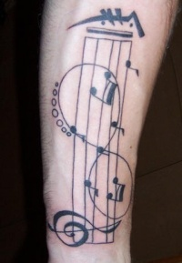 Musical staff and infinity symbol on arm